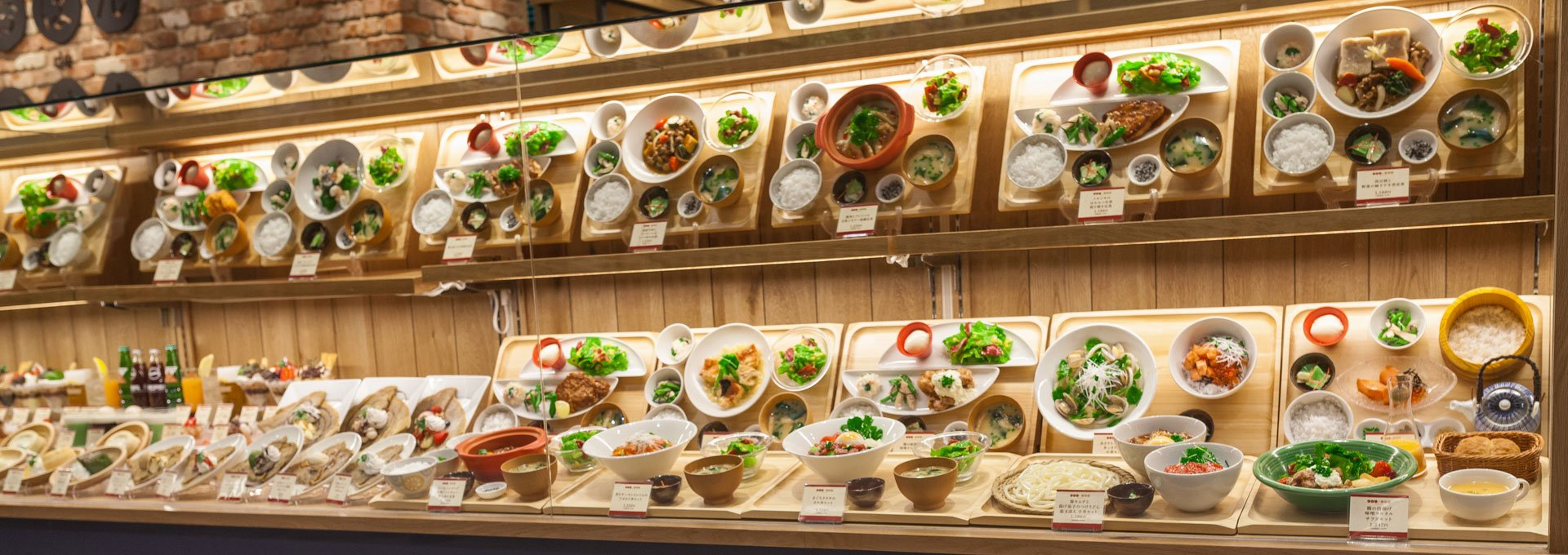 A restaurant displays tons of bowls and plates of plastic food to showcase their menu